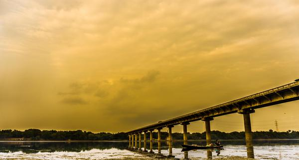 Image of Sky, Water, Cloud, Bridge, Yellow, River etc.