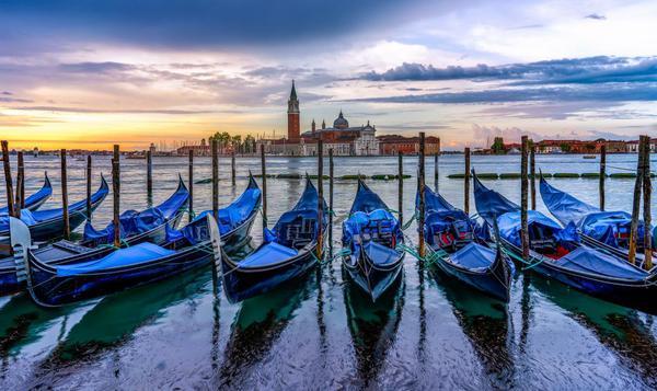 Image of Gondola, Water transportation, Boat, Reflection, Waterway, Sky etc.