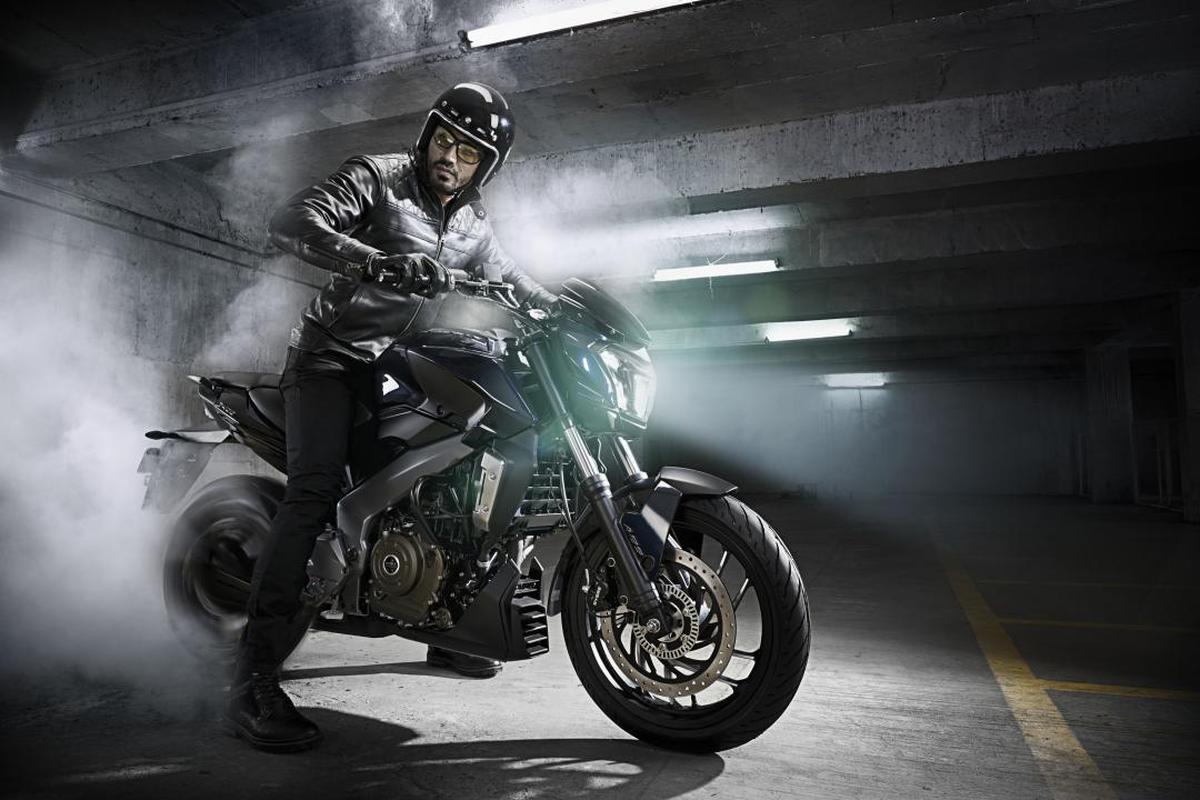 Image of Land vehicle, Motorcycle, Vehicle, Motorcycling, Stunt performer, Automotive tire etc.